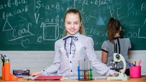 Girls study chemistry in school. Microscope test tubes chemical reactions. Pupils at chalkboard. Fascinating science. Formal education school. Educational stock photos