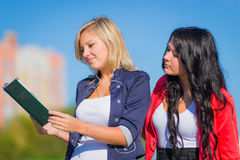Girls studying outdoor Stock Images