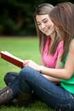 Girls studying outdoors Royalty Free Stock Image