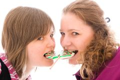 The girls with a sugar candy Royalty Free Stock Images
