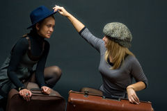 Girls with suitcase Stock Images