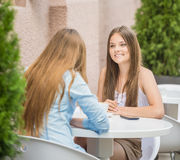 Girls in summer cafe Stock Photo