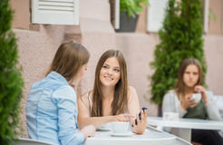 Girls in summer cafe Stock Photography