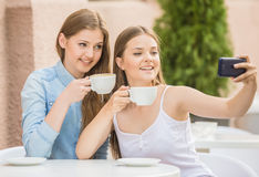 Girls in summer cafe Royalty Free Stock Photo