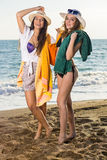 Girls in Summer Clothing at the Beach Stock Images