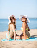 Girls sunbathing on the beach Stock Image