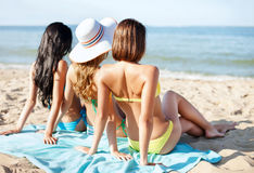 Girls sunbathing on the beach Stock Photography