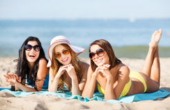 Girls sunbathing on the beach Royalty Free Stock Photo