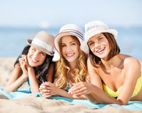 Girls sunbathing on the beach Stock Images