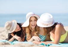 Girls sunbathing on the beach Royalty Free Stock Photo