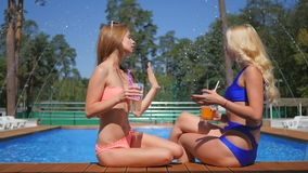 Girls are sunbathing near the swimming pool stock video footage