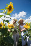 Girls with sunflower Stock Image