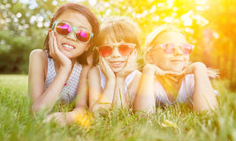 Girls with sunglasses at meadow in summer Stock Photos