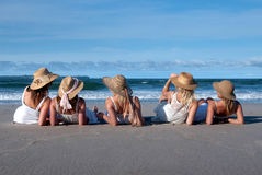 Girls in sunhats Stock Photo
