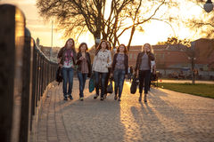 Girls at sunset in the city park Stock Photography