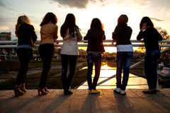 Girls at sunset in the city park Royalty Free Stock Photography