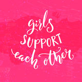 Girls support each other. Inspirational feminism quote. White modern lettering at pink background. Stock Photos