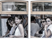 Girls with suspicious look in Tram. The Lisbon tramway network serves the municipality of Lisbon, capital city of Portugal. Royalty Free Stock Photography
