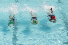 Girls Swim Lessons. Young girls swimming pool lessons learning to swim stock photos