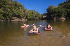 Girls Swimming Beach Lagoon Stock Photography