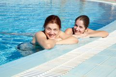Girls in  swimming pool Stock Photography