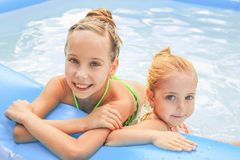 Girls swimming in the pool. stock photos