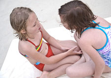Girls in Swimsuits Talking Royalty Free Stock Image