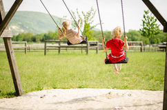 Girls in swing royalty free stock photography