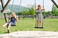 Girls swinging Royalty Free Stock Photography