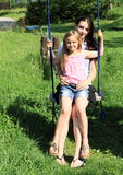 Girls swinging on swing Royalty Free Stock Images