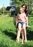 Girls swinging on swing Royalty Free Stock Image