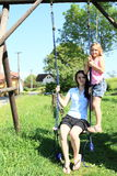 Girls swinging on swing Stock Photos