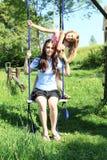 Girls swinging on swing Royalty Free Stock Image