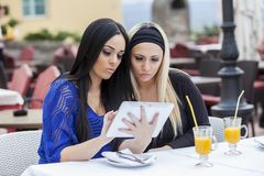 Girls with tablet Stock Photography