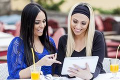 Girls with tablet Stock Photos
