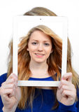 Girls with tablet. Isolated on white background Royalty Free Stock Photo