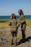 Girls take procedures with healing mud. Russia royalty free stock photos