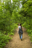 Girls takes a stroll in the woods. Royalty Free Stock Photo