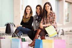 Girls taking a break from shopping Royalty Free Stock Photography