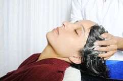 Girls taking hair bath in salon by a professional. Lady having hair treatmant in Stock Image
