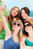 Girls taking photo in cafe on the beach Royalty Free Stock Images