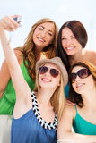 Girls taking photo in cafe on the beach Royalty Free Stock Photo
