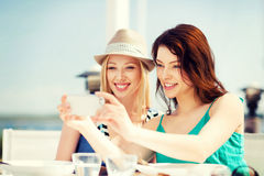 Girls taking photo in cafe on the beach Stock Photo