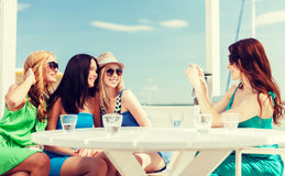 Girls taking photo in cafe on the beach Royalty Free Stock Photography