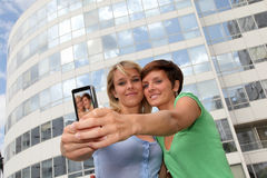 Girls taking picture Stock Photos