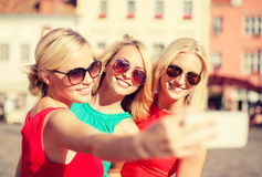 Girls taking picture with smartphone camera Royalty Free Stock Image