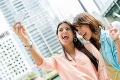 Girls taking a picture Stock Image