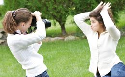 Girls taking pictures on nature Stock Photo