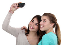 Girls taking pictures of themselves Royalty Free Stock Photos