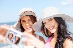 Girls taking self portrait on the beach Stock Photo